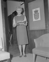 Marie Bruce, Dean of Women at Mankato State College, standing posed in the doorway of her office, 1962-01-15.