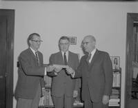 Mankato State College President, C. L. Crawford, accepting check from Honeymead for MSC Foundation, 1962-04-30.