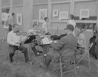 A string quartet playing at an art fair in the Science and Arts Courtyard at Mankato State College, 1962-05-18.