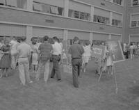 Students at an Art Fair in the the Science and Arts Courtyard at Mankato State College, 962-05-18.