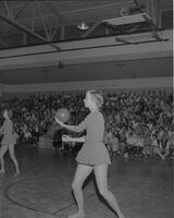 A Danish female gymnast with a ball at Mankato State College, 1962-05-18.
