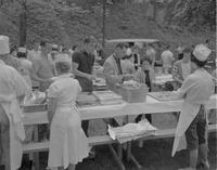 Students at Mankato State College going through food lines at the All-College picnic, 1962-05-21.