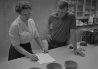 Mr. Sarenpa giving motion picture demonstration to teachers in ceramics lab, Mankato State College, 1963-05-16.