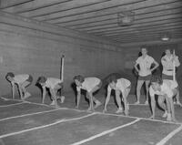 Mankato State College girls lined up for dash during Physical Education Department intramural track meet, 1962-05-25.