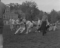 Intramural track meet tug of war at Mankato State College, 1962-06-04.