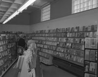 Students browsing the Mankato State College Bookstore, 1962-06-19.