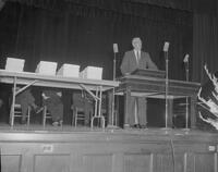 Unidentified man speaking at a Commencement Ceremony, 1962-08-30.