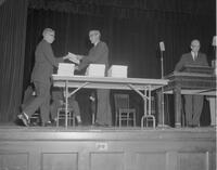 F. Kelton Gage awarding diplomas at a Mankato State College Commencement ceremony, 1962-08-30.