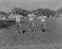 Mankato State College Football Players throwing passes, 1962-09-13.