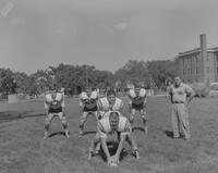 Coach Barney Lewellyn watching the Mankato State College Football Team, 1962-09-13.