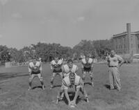Coach Barney Lewellyn watching the Mankato State Football Team, 1962-09-13.