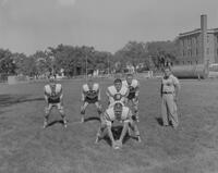 Coach Lewellyn watching the Mankato State College Football Team, 1962-09-13.