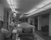 Mankato State College student being served at the cafeteria, 1962-09-24.