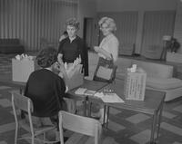 A woman helping new students at Mankato State College, 1962-09-24.