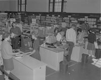 Mankato State College Students at the Wigwam Bookstore, 1962-09-24.