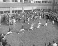 Cheerleaders at the Homecoming Pep Rally, Mankato State College, 1962-11-09.