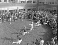 Cheerleaders performing at the Homecoming Pep Rally, Mankato State College, 1962-11-09.