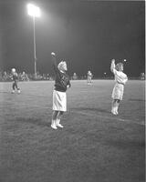 Mankato State College Cheerleaders, Nancy Parkinson and Jo Schiller at a Football game, 1962-01-24.