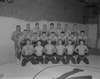 Mankato State College Wrestling team in uniform with coaches, 1962-11-16.