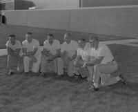 Gordon Graham (2nd from left) with football coaches, Mankato State College, 1964-09-30.