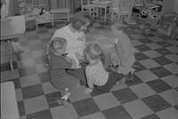 Jan with nursery children and a rabbit at Mankato State College, 1964-11-06.