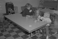 Barb watching children play with Play-Doh at Mankato State College, 1964-11-06.