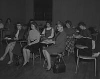 Women and Kenneth Brown at a SNEA meeting, Mankato State College, 1963-03-22.