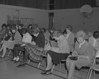 Students gathering for El Sta Ma presentation, Mankato State College, 1963-02-23.