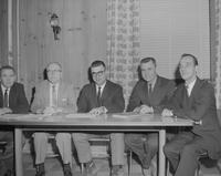 Group of men sitting at a table, Mankato State College, 1963-03-22.