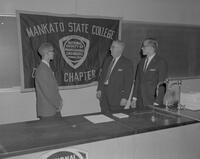 Mr. Scholmeier and Dr. Higgins at Engineering Club meeting, Mankato State College, 1963-04-25.