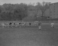 Spring football action at Mankato State College, 1963-05-08.