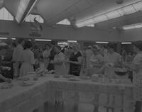 Women getting food at the Mother-Daughter Tea, Mankato State College, 1963-05-21.