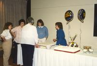 Five women celebrating Anita Stone's retirement, Centennial Student Union at Mankato State University. 04-03-1989.