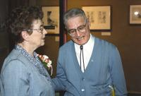 Man and woman celebrating Anita Stone's retirement, Centennial Student Union at Mankato State University. 04-03-1989.