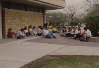 Students sitting outside of Armstrong Hall for class at Mankato State University, 1990-04-26.