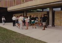 Students interacting with one another during class outside of Armstrong Hall, Mankato State University, 1990-04-26.
