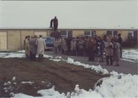 A picture of a group of people gathered outside the Mankato State University Wiecking Center building for a ground-breaking ceremony of a still building that would be constructed next to Wiecking, 1970s.