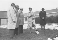 A picture of Mankato State University president, Margaret R. Preska (holding shovel), Dr. Claire Faust (left of Preska) and three other men gathered outside of the Wiecking Center building for a ground-breaking ceremony, 1970s.