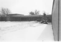 A picture of a path in the snow leading to the Mankato State University Wiecking Center building, 1980s.