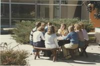 A picture of a Mankato State University nursing class sitting in the Wiecking Center courtyard, 1985.