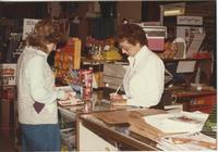 A picture of a Mankato State University student purchasing something in the MSU Centennial Student Union, 1980s.