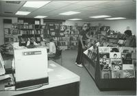 A picture of three Mankato State University students in the Centennial Student Union bookstore, 1970s.