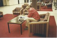 A picture of an older Mankato State University student studying in the lower level of the Centennial Student Union, 1980s.