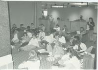 A picture of Mankato State University students watching television in a Centennial Student Union lounge, 1980s.