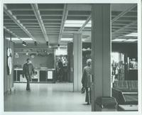 A picture of a man walking through the Mankato State University Centennial Student Union, 1970s.
