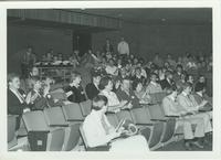 A group of people in the Centennial Student Union's Ostrander Auditorium applauding, Mankato State University, 1970s.