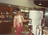 A picture of a Mankato State University student getting in a beverage in the food court area of the Centennial Student Union, 1980s.