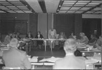 A picture of Mankato State University president Margaret R. Preska (second from right against wall) during a meeting in a Centennial Student Union conference room, 1980s.