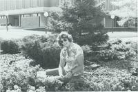 A picture of a Mankato State University student working in a flower garden on the university Campus Mall, 1970s.