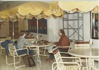 A picture of two Mankato State University students talking in the MSU Centennial Student Union, 1980s.